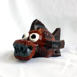 Brown and grey piranha sculpture by Amber Tyreman