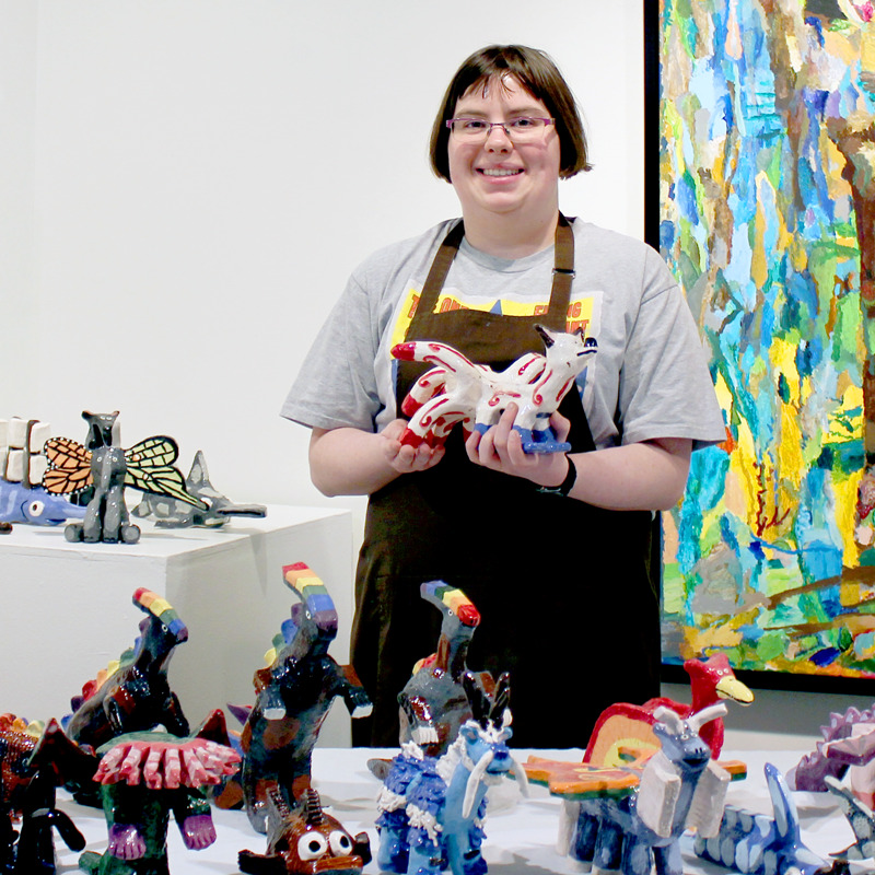 Amber Tyreman surrounded by her many sculptures