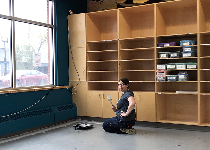Cynthia painting the floors of the new fabric studio