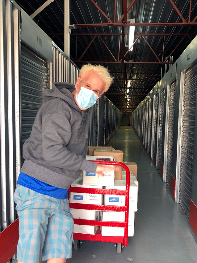 Darren with a cart of boxes at Sentinel Storage