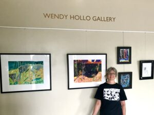 "Wendy in front of the newly named ""Wendy Hollo Gallery"""