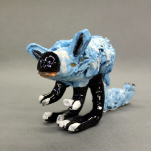 Ceramic sculpture of a blue kangaroo rat with black feet and nose