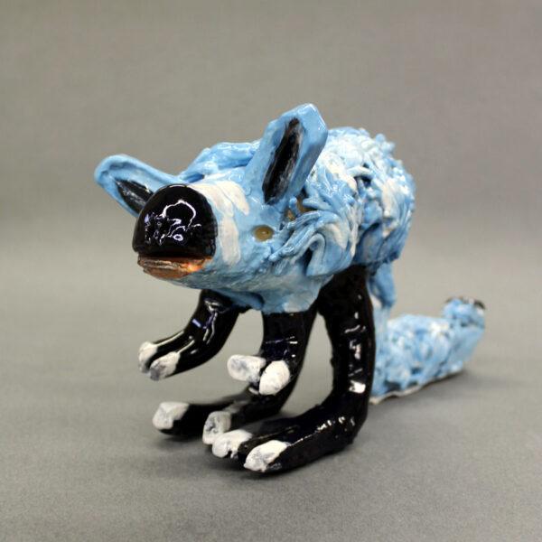 Ceramic sculpture of a blue kangaroo rat with black feet and nose