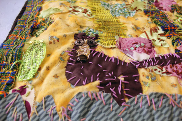 Detail of the bear in Montana's textile collage
