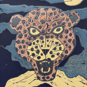 Relief print of a leopard head in a night sky by Steven Niles