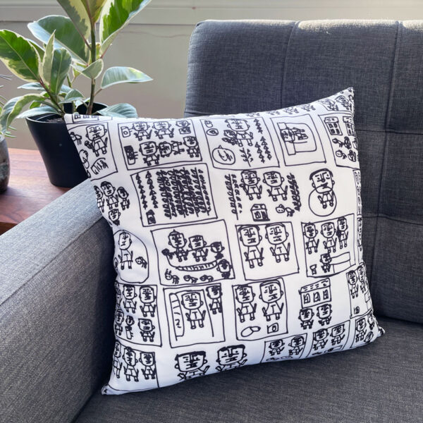 White square pillow with black figures drawn by Kim Hung Ho