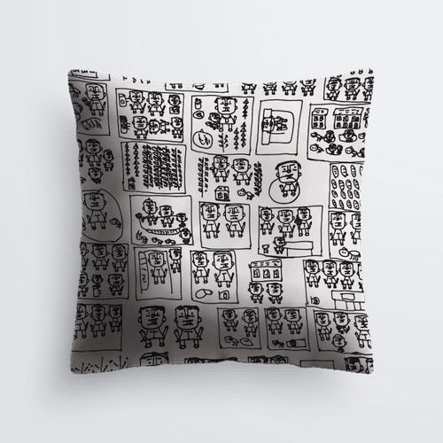 White square pillow with black figures
