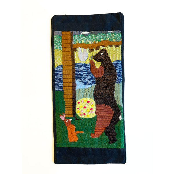 Tapestry of a bear and rabbit in the forest