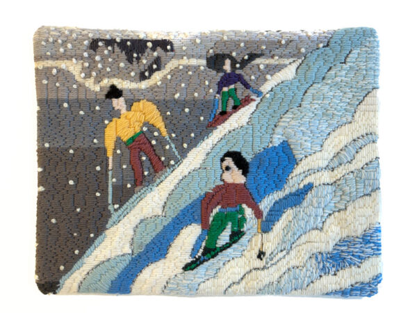 Needlework of three downhill skiers