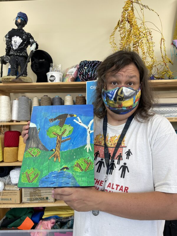 Jared Quinney holding is falcon painting