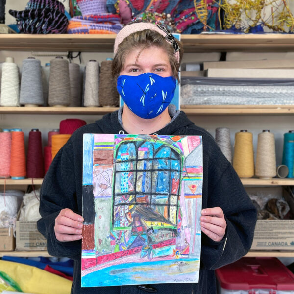 Ashley holding her artwork